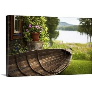 """Wooden rowboat in backyard"" Canvas Wall Art"