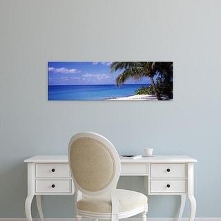 Easy Art Prints Panoramic Image 'Palm tree on the beach, Seven Mile Beach, Grand Cayman, Cayman Islands' Canvas Art