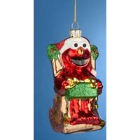 """4.5"""" Sesame Street Glittered Red Elmo Sitting in a Rocking Chair Holding a Gift Christmas Ornament"""