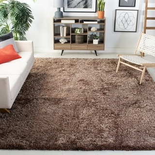 Link to Safavieh Handmade South Beach Leonella Shag Solid Polyester Rug Similar Items in Shag Rugs