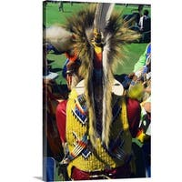 Premium Thick-Wrap Canvas entitled Rear view of man wearing native american indian ceremonial costume. - Multi-color
