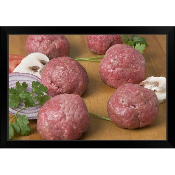 """Raw meatballs on a cutting board"" Black Framed Print"