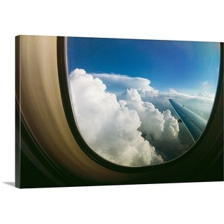 Premium Thick-Wrap Canvas entitled Watching the clouds pass by through a window of an airplane