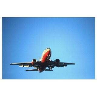 """Aeroplane flying across blue sky"" Poster Print"