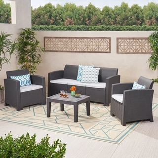 Link to Jacksonville Outdoor 4-piece Wicker Cushioned Chat Set by Christopher Knight Home Similar Items in Outdoor Sofas, Chairs & Sectionals