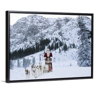 """A team of Husky dogs pulling Santa Claus and his sleigh"" Black Float Frame Canvas Art"