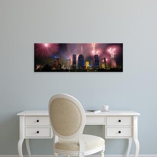 Easy Art Prints Panoramic Images's 'Fireworks Over Buildings In A City, Houston, Texas, USA' Premium Canvas Art