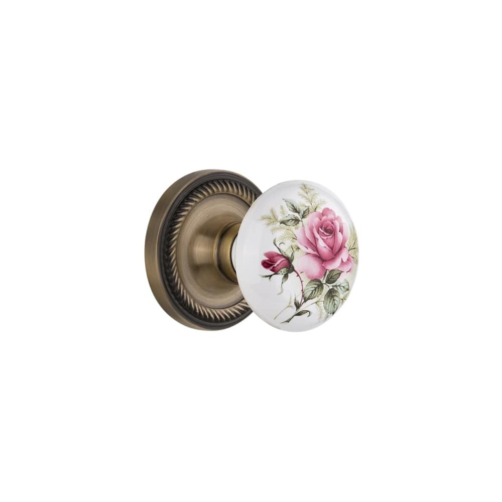 Nostalgic Warehouse ROPROS_PRV_234_NK  Rose Porcelain Solid Brass Privacy Knob Set with Rope Rose and 2-3/4 Backset (Antique Brass)