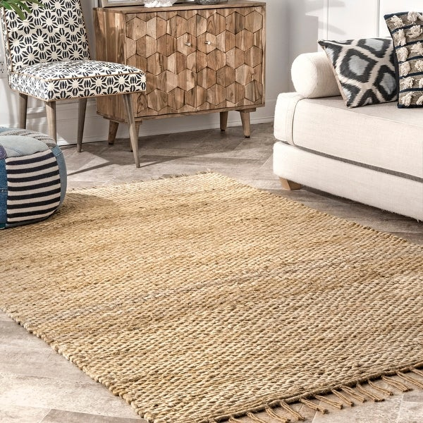 The Curated Nomad Nevada Natural Jute Handmade Tassel Area Rug. Opens flyout.