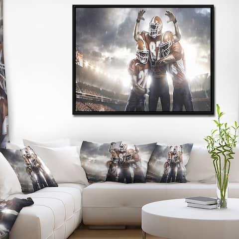 Designart 'American Football Players on Stadium' Sport Framed Canvas Art Print
