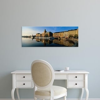 Easy Art Prints Panoramic Images's 'Reflection Of Buildings On Water, Stockholm, Sweden' Premium Canvas Art