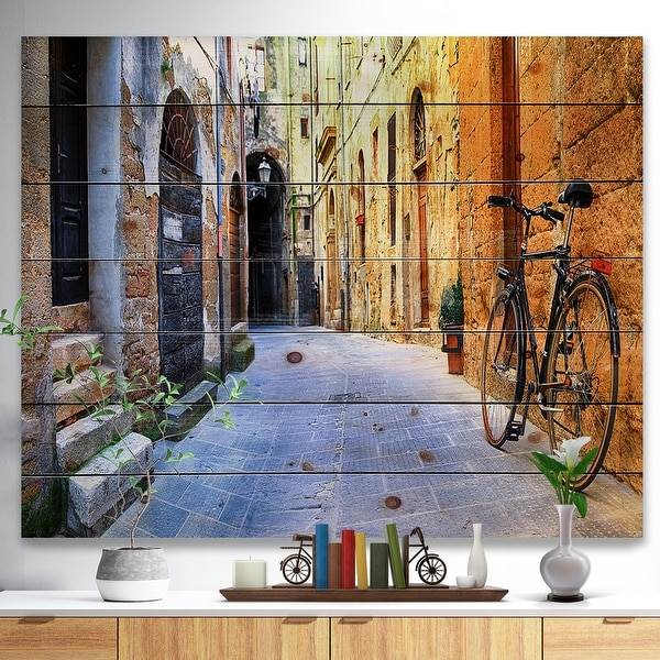 Designart 'Pictorial Street of Old Italy' Cityscape Print on Natural Pine Wood - Yellow. Opens flyout.