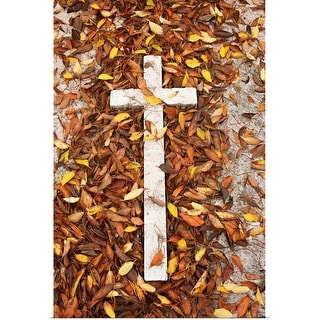 """Fallen leaves and a white cross on a gravestone"" Poster Print"
