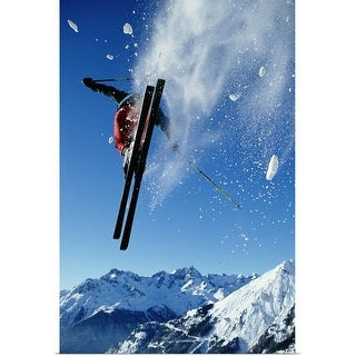 """Downhill skier in mid-air, rear view"" Poster Print"
