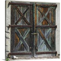 Premium Thick-Wrap Canvas entitled Old rustic barn doors - Multi-color