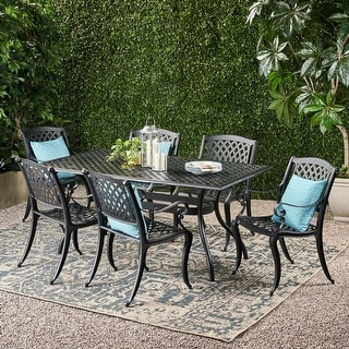 Link to Cayman Outdoor 7-piece Cast Aluminum Black Sand Dining Set by Christopher Knight Home Similar Items in Patio Furniture