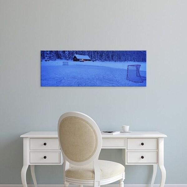 Easy Art Prints Panoramic Image 'Hockey net on a snowcapped landscape, Lake Louise, Alberta, Canada' Premium Canvas Art