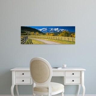 Easy Art Prints Panoramic Images's 'Fence along a road, Sneffels Range, Colorado, USA' Premium Canvas Art