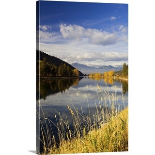 """""""Clouds and distant snowcapped mountains reflected in Kootenai River, Montana"""" Canvas Wall Art"""