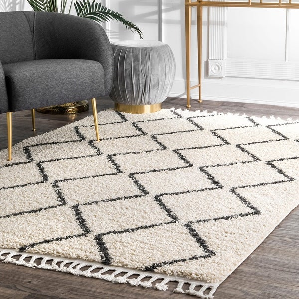 The Curated Nomad Philo Off-white Moroccan Trellis Plush Tassel Shag Area Rug. Opens flyout.