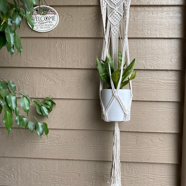 "33"" H hanging macrame planter hanger. Opens flyout."