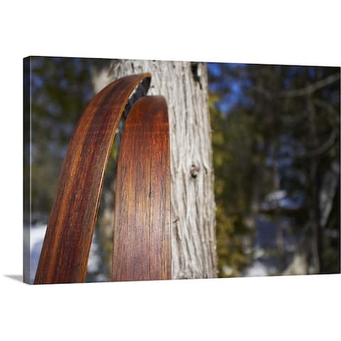 """Nordic skis leaning against tree"" Canvas Wall Art"