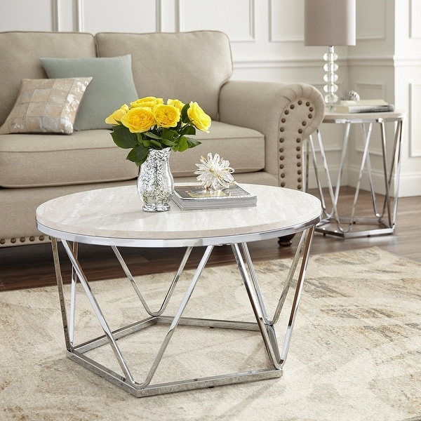 Silver Orchid Henderson Faux Stone Silvertone Round Coffee Table. Opens flyout.