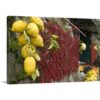 Premium Thick-Wrap Canvas entitled Close-up of lemons and chili peppers in a market stall, Sorrento, Naples, Campania,