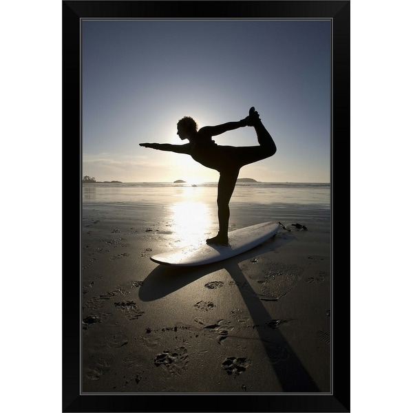 """silhouette of female surfer doing bow pulling yoga pose"" Black Framed Print"