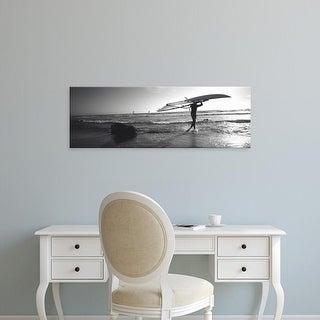 Easy Art Prints Panoramic Image 'Man carrying a surfboard on the beach, Santa Cruz, California' Canvas Art