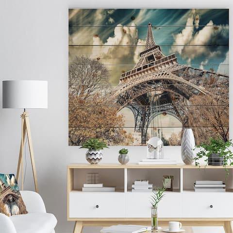 Designart 'Street View of Paris Eiffel Tower' Cityscape Digital Art Print on Natural Pine Wood - Yellow