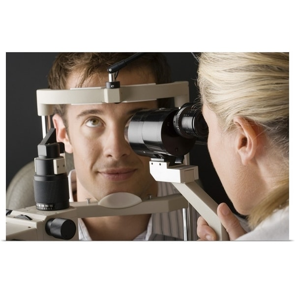 """Doctor looking at eye with slit lamp"" Poster Print"