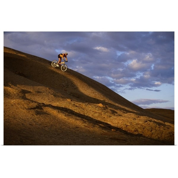 """Mountain biker descending Slickrock Trail , Moab , UT"" Poster Print"