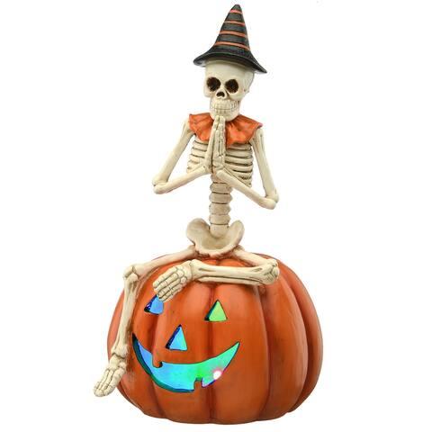 "12"" Skeleton Sitting on Pumpkin"
