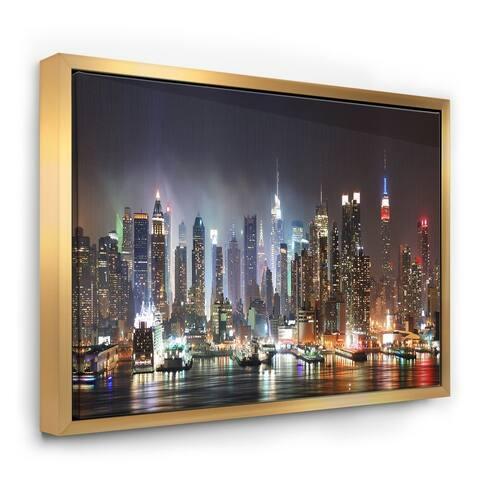 Designart 'Lit NYC Manhattan Skyline' Cityscape Photo Framed Canvas Print