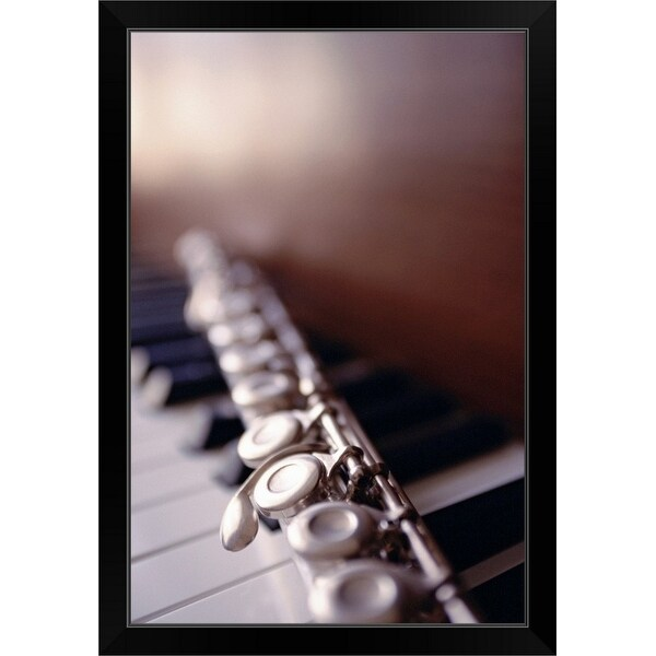 """Close-up of flute on piano keys"" Black Framed Print"