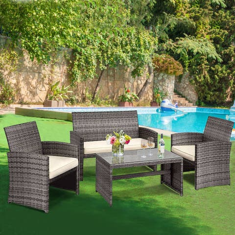 Gymax 4PCS Patio Outdoor Rattan Furniture Set w/ Cushioned Chair