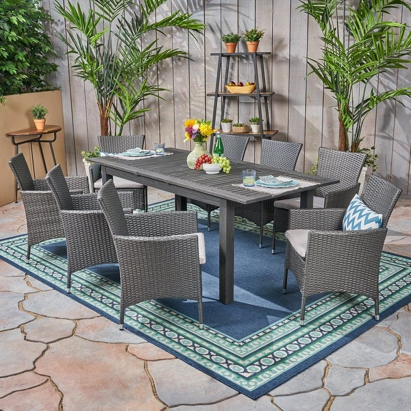 Nadia 9-piece Wood/ Wicker Expandable Dining Set by Christopher Knight Home. Opens flyout.