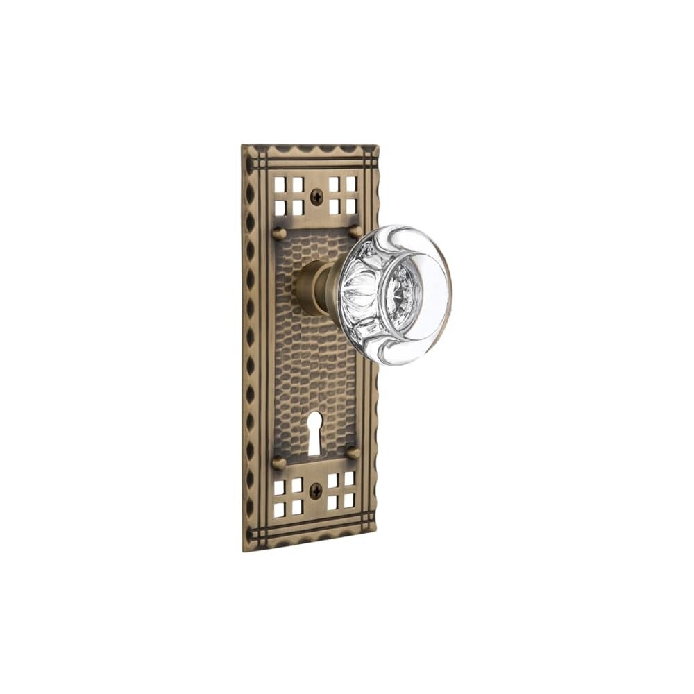 Nostalgic Warehouse CRARCC_PRV_238_KH  Round Clear Crystal Solid Brass Privacy Knob Set with Craftsman Rose, Keyhole and 2-3/8 (Oil-Rubbed Bronze)