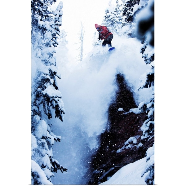 """A snowboarder jumping off a cliff in the backcountry in Colorado."" Poster Print"