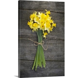 Premium Thick-Wrap Canvas entitled Bunch of daffodils on a wooden table