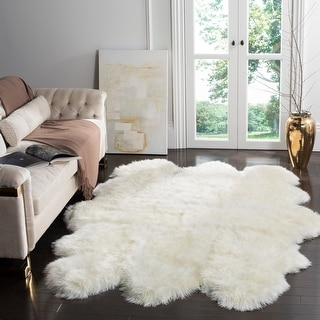 Link to Safavieh Handmade Natural Sheepskin Leanca Shag Solid Rug Similar Items in Shag Rugs