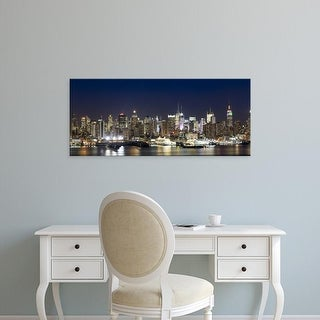 Easy Art Prints Panoramic Image 'Buildings in a city lit up, Hudson River, Manhattan, New York City' Canvas Art