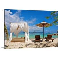 Premium Thick-Wrap Canvas entitled Sunbeds on a tropical beach facing a turquoise sea - Multi-color