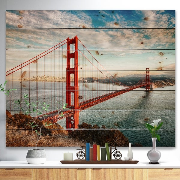 Designart 'Golden Gate Bridge in San Francisco' Sea Bridge Print on Natural Pine Wood - Blue. Opens flyout.