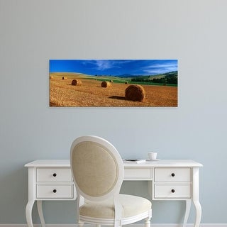 Easy Art Prints Panoramic Images's 'Hay bales in a field, Val d'Orcia, Siena Province, Tuscany, Italy' Canvas Art