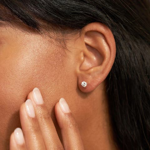 5/8ct TDW Diamond Solitaire Stud Earrings in 14k Gold by De Couer
