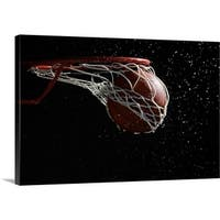Premium Thick-Wrap Canvas entitled Basketball going through hoop - Multi-color