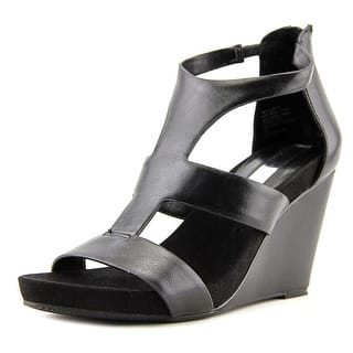 INC International Concepts Lilbeth W Open Toe Synthetic Wedge Heel https://ak1.ostkcdn.com/images/products/is/images/direct/e7564355060afd5d19052c8fd5b812c99b808617/INC-International-Concepts-Lilbeth-W-Open-Toe-Synthetic-Wedge-Heel.jpg?impolicy=medium
