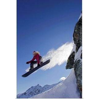 """Female snowboarder jumping off a rock"" Poster Print"